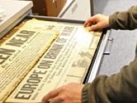 A drawer with old newspapers