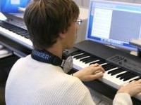 Music student on a keyboard